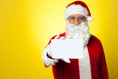 Santa holding blank white placard Royalty Free Stock Images