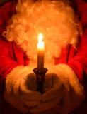 Santa Holding Candle Royaltyfria Foton