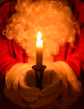 Santa Holding Candle Royalty Free Stock Photos