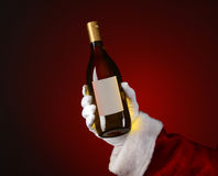 Santa Holding Chardonnay Wine Bottle Royalty Free Stock Photos