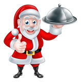 Santa Holding Christmas Dinner Images libres de droits