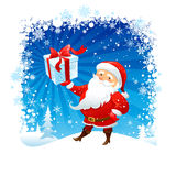 Santa holding Christmas gift Stock Photo