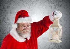 Santa holding christmas lantern Royalty Free Stock Photos