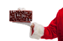 Santa holding a Christmas present Royalty Free Stock Photos