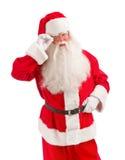 Santa Holding Christmas Present en sus manos en un Backgrou blanco Fotografía de archivo libre de regalías
