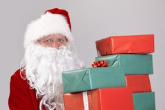 Santa holding christmas presents stock image