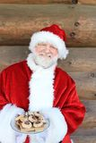 Santa Holding Cookie Plate Royalty Free Stock Image