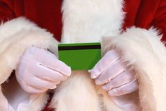 Santa Holding Credit Card Stock Photos