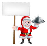 Santa Holding Dinner and Sign Royalty Free Stock Photography