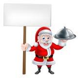 Santa Holding Dinner y muestra Fotografía de archivo libre de regalías