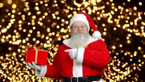 Santa is holding the gift box. stock footage