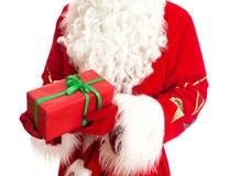 Santa is holding gift. Royalty Free Stock Image