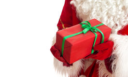 Santa is holding gift. Royalty Free Stock Photography