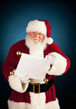 Santa: Holding the Good and Bad List Royalty Free Stock Images