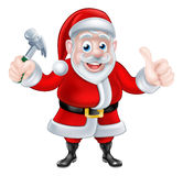 Santa Holding Hammer and Giving Thumbs Up Royalty Free Stock Photography