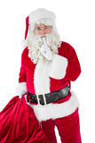 Santa holding his sack and keeping a secret Royalty Free Stock Photo