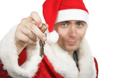 Santa holding keys Stock Photography