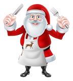 Santa Holding Knife y bifurcación Fotos de archivo libres de regalías