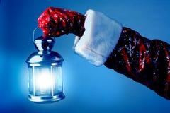Santa holding a lamp Royalty Free Stock Image