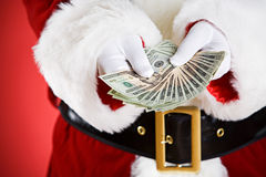 Santa: Holding Out A Money Fan Royalty Free Stock Photography