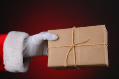 Santa Holding a Parcel Royalty Free Stock Image