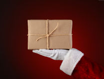 Santa Holding a Parcel in His Palm Stock Photo