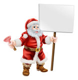 Santa holding plunger and sign Stock Photography