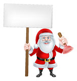 Santa Holding Plunger Sign Stock Photos