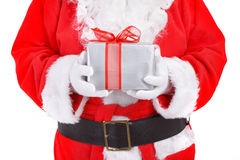 Santa holding present Royalty Free Stock Photo