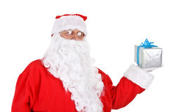 Santa holding present Stock Photo