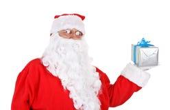 Santa holding present Stock Photo