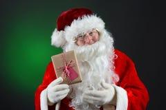 Santa Holding Present Imágenes de archivo libres de regalías