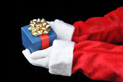 Santa Holding Present in Both Hands Stock Photography