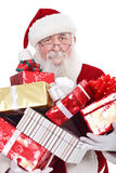 Santa holding presents. Santa Claus or Father Christmas holding a large pile of presents, isolated on white background stock photo