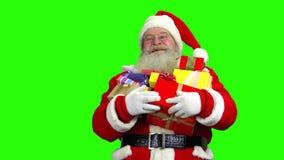 Santa holding presents, green screen. stock video footage