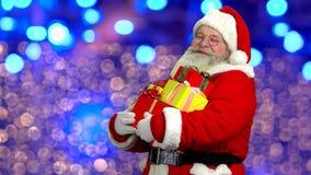 Santa holding presents. stock footage