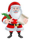 Santa Holding Scroll and Quill Royalty Free Stock Images