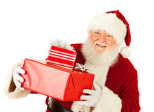 Santa: Holding Several Wrapped Gifts Stock Image