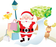 Santa holding shopping list Stock Photos
