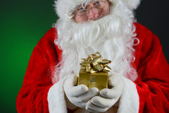 Santa Holding Small Gift Royalty Free Stock Images