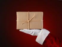 Santa Holding som en jordlott i hans gömma i handflatan Arkivfoto