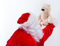 Santa holding a teddy bear. Isolated on white background stock photos