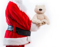 Santa holding a teddy bear. Isolated on white background royalty free stock image