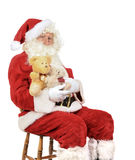 Santa Holding Teddy Bears Stock Photography
