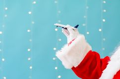 Santa holding a toy airplane. On a shiny light blue background royalty free stock images