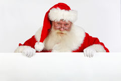 Santa holding white banner Stock Photos
