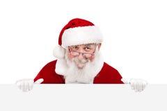 Santa holding white blank banner Royalty Free Stock Image