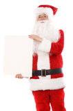 Santa holding a white card Royalty Free Stock Photography