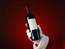 Santa Holding Wine Bottle Royalty Free Stock Image