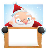 Santa holding wooden banner Royalty Free Stock Photography